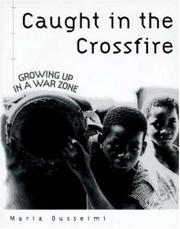 CAUGHT IN THE CROSSFIRE by Maria Ousseimi