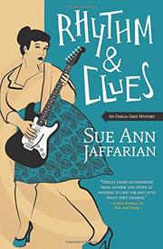 RHYTHM & CLUES  by Sue Ann Jaffarian