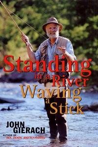 STANDING IN A RIVER WAVING A STICK
