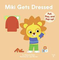 MIKI GETS DRESSED